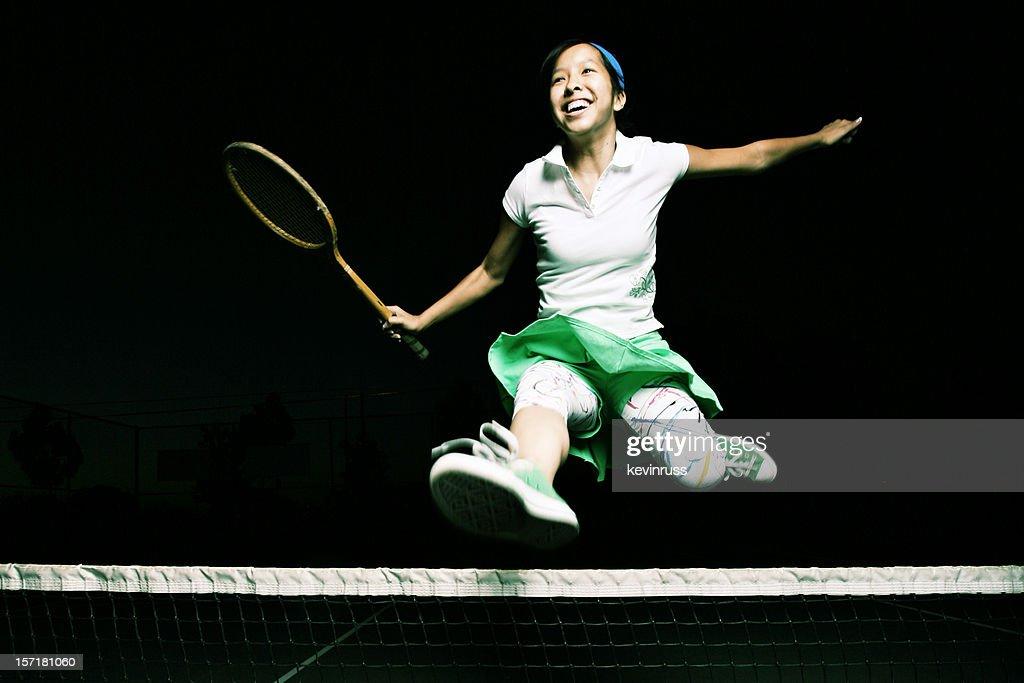 Cheerful Jumping Tennis Player : Stock Photo