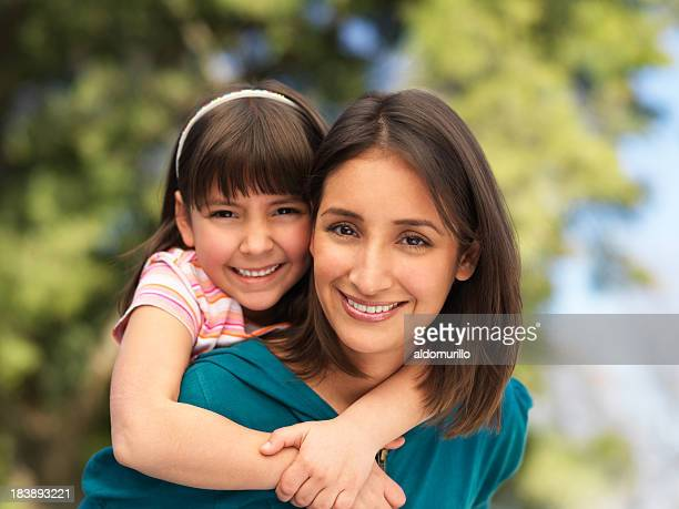 Cheerful latin mother and daughter