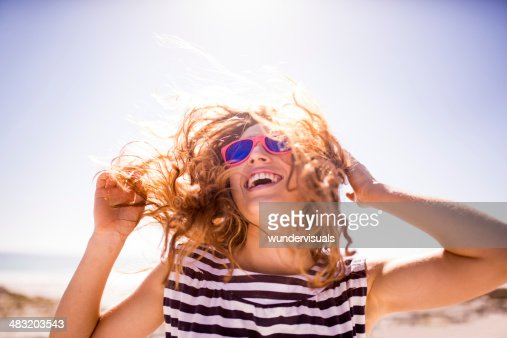 Cheerful laughing woman on the beach