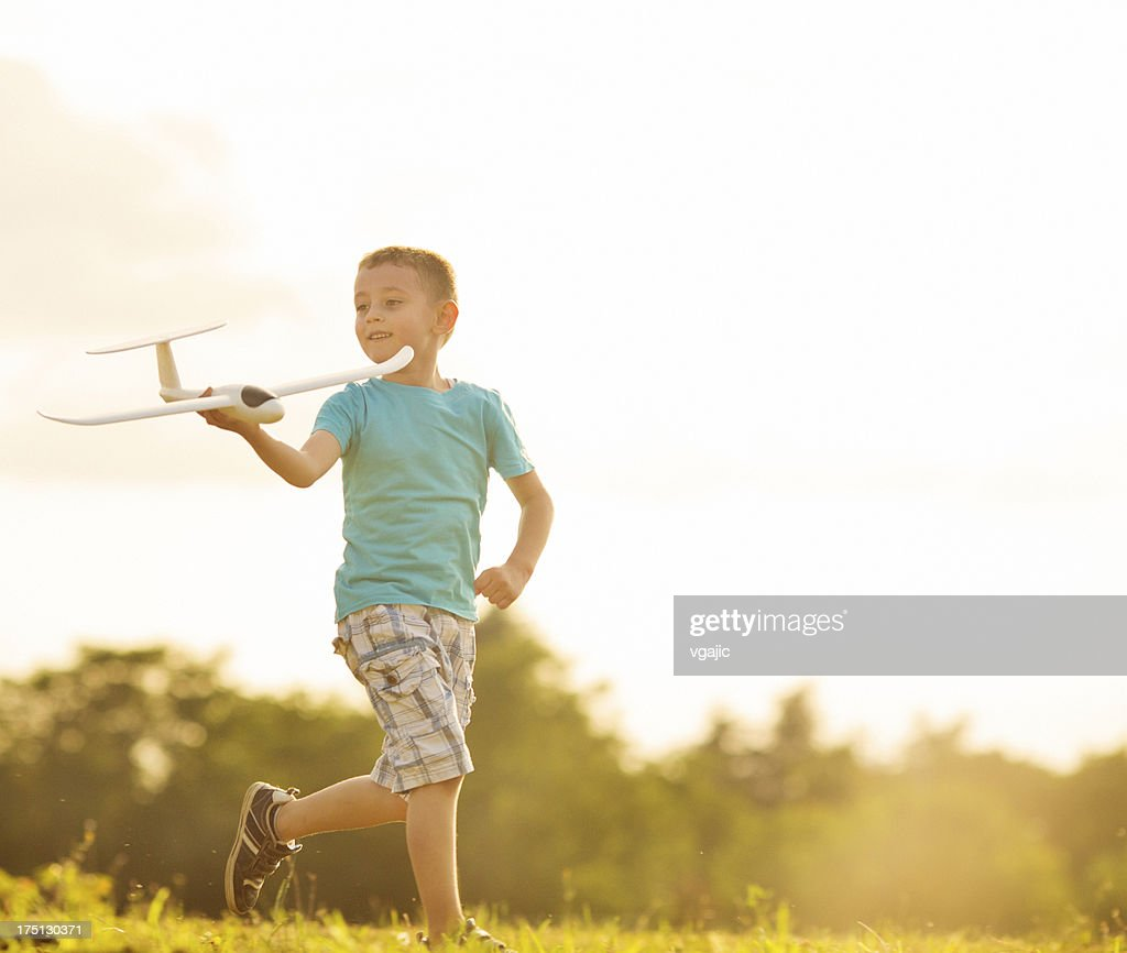 Cheerful Little Boy Having Fun With Toy Airplane Outdoors. : Stock Photo
