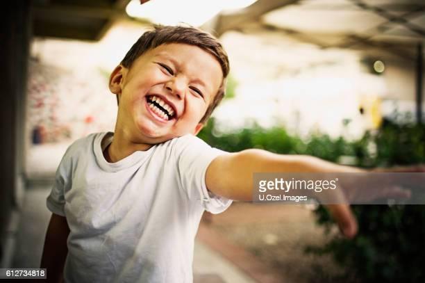 Cheerful Little Boy Outdoors Portrait