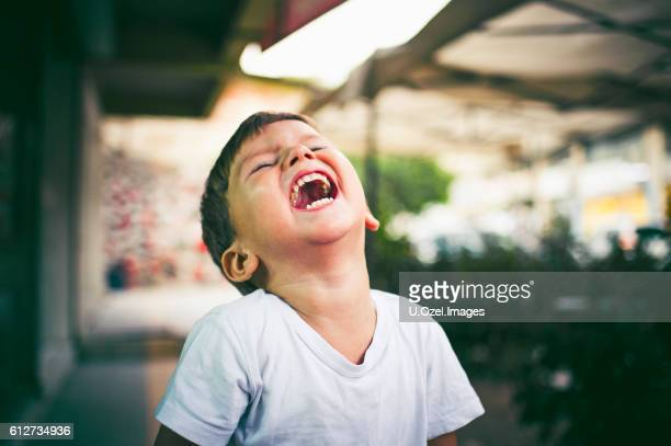 Cheerful Little Boy Outdoors Portrait