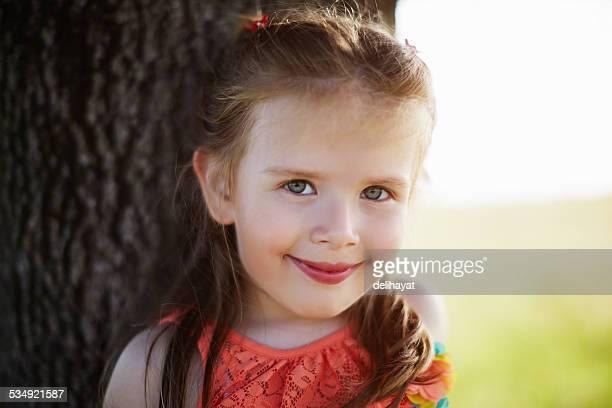 Cheerful little girl enjoying the nature