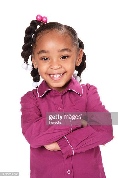 Cheerful Little Girl Standing with Arms Folded