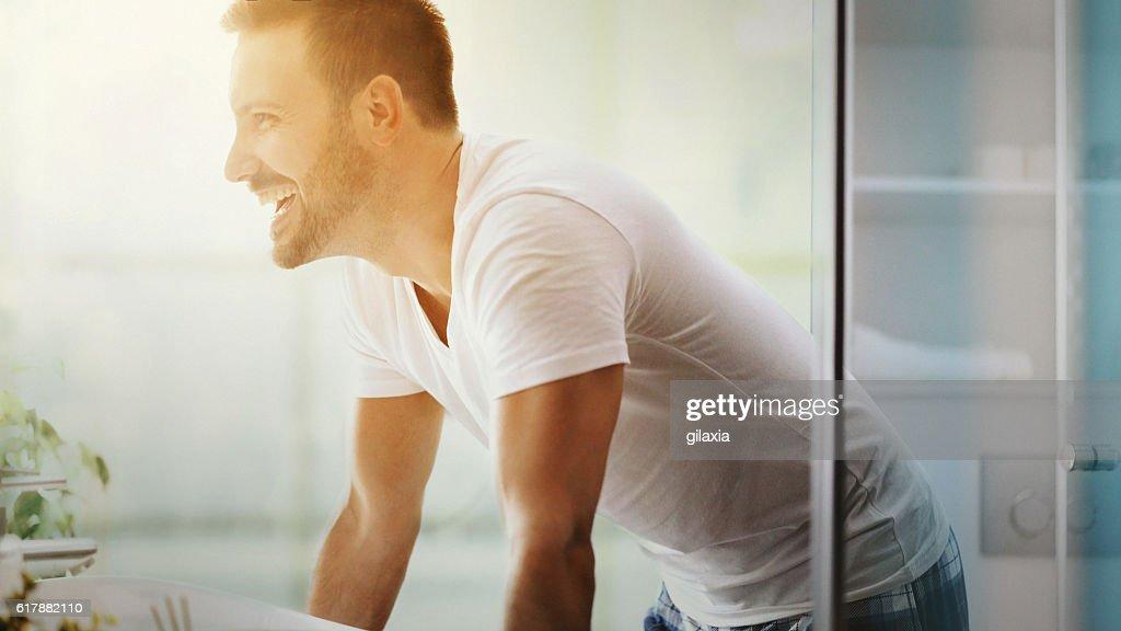 Cheerful man in bathroom. : Stock-Foto