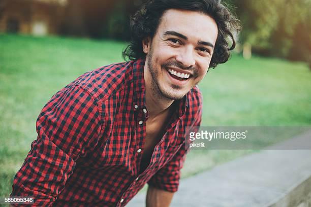 Cheerful man in green area