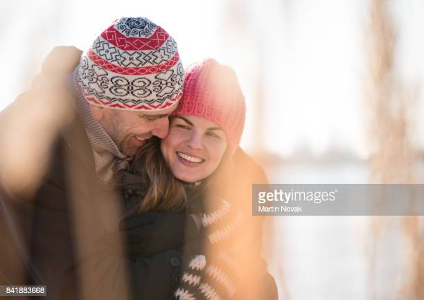 Cheerful mature couple hugging in love