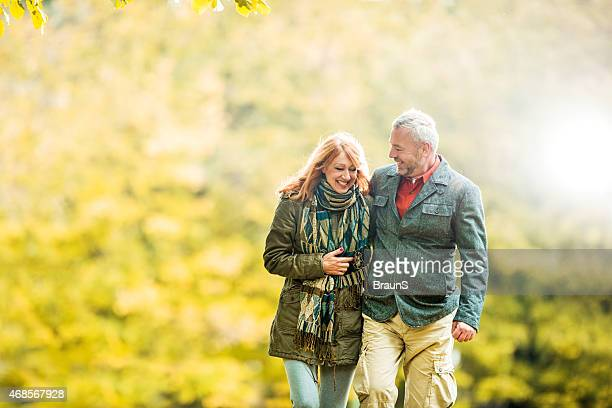 Cheerful mature couple walking together in nature.