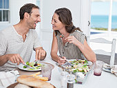 Cheerful mid adult couple having lunch together