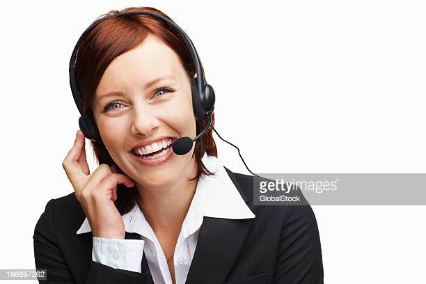 Cheerful middle aged woman wearing headset