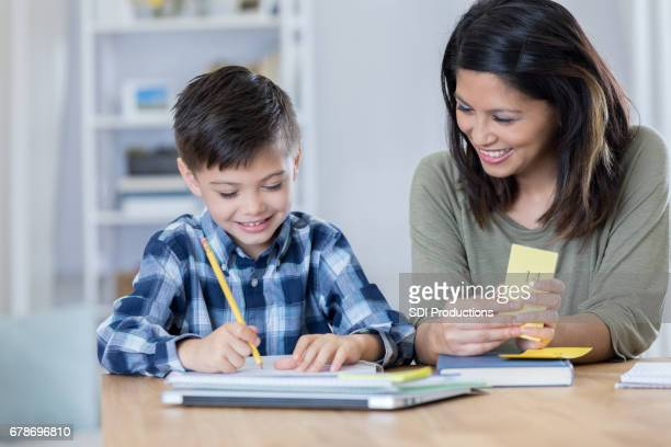 Cheerful mom homeschools young son