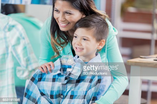 Cheerful mom shops with young son : Stock Photo