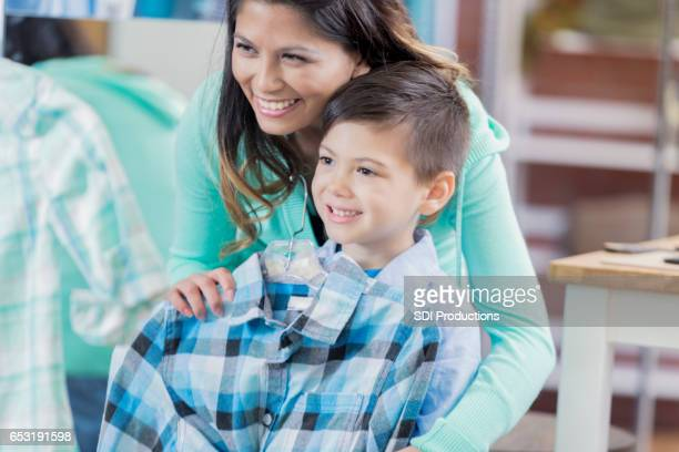 Cheerful mom shops with young son