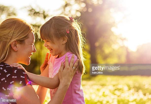 Cheerful mother and child in nature in springtime