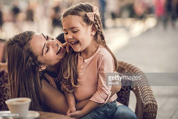 Cheerful mother and daughter having fun together during the day.