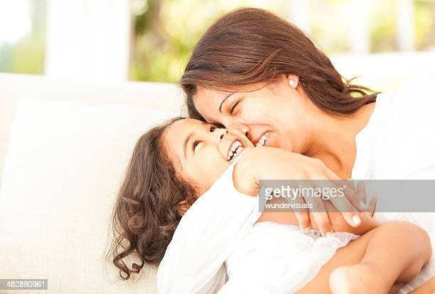 Cheerful Mother And Daughter Playing Around