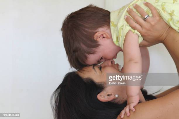 Cheerful mother lifting son
