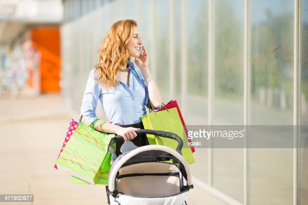 Cheerful Mother Shopping and Pushing Strollers.