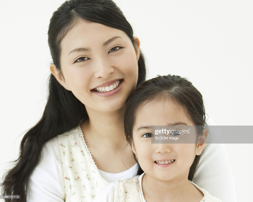 Cheerful Mother With Her Daughter : Stock Photo