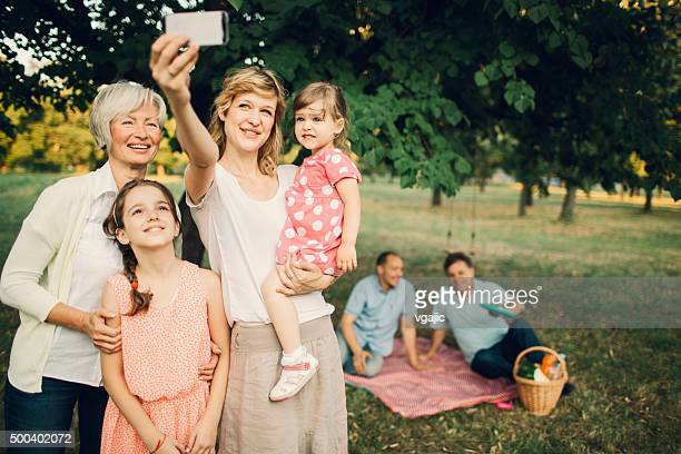 Cheerful Multi-Gebration Family Standing Outdoors And Making Selfie.