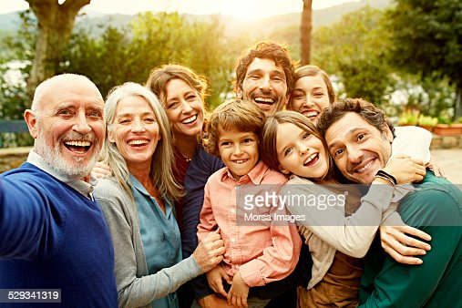 Cheerful multi-generation family at yard