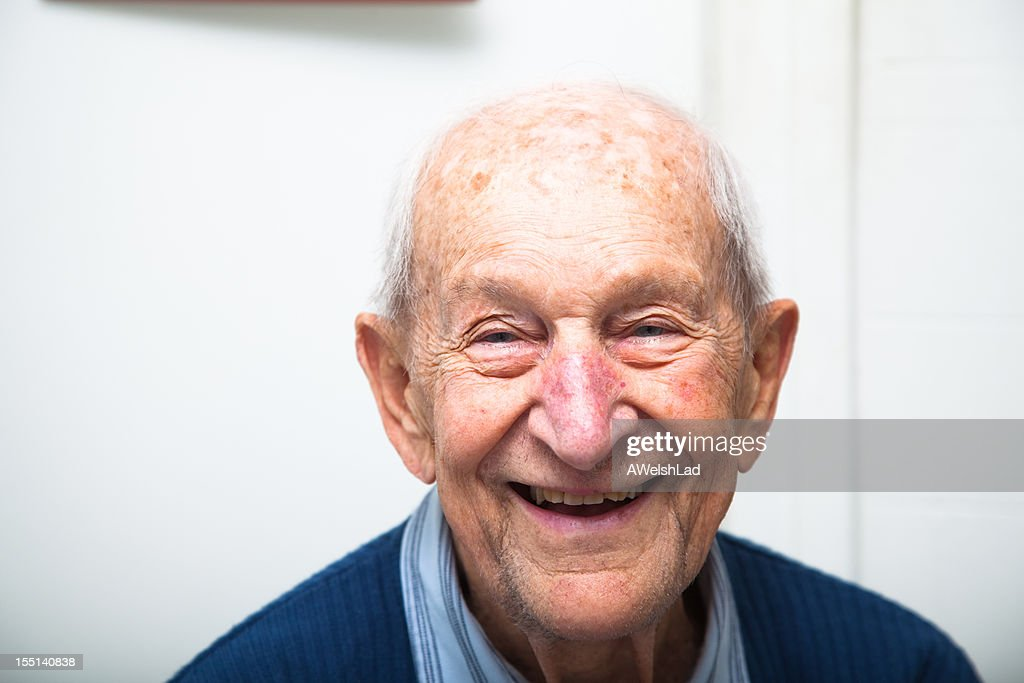 Cheerful ninety year old senior man in his house