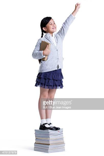 Cheerful schoolgirl posing