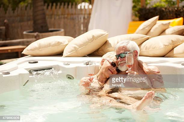 Cheerful Senior Couple Enjoying Summer Vaccations in Jacuzzi