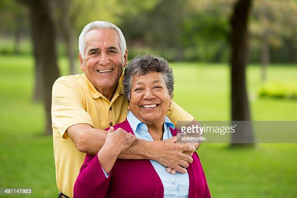 Cheerful Senior couple hugging in the park