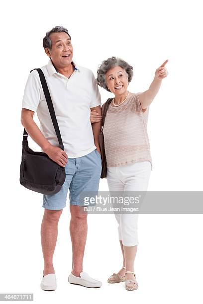 Cheerful senior couple looking at view