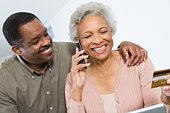 Cheerful Senior Couple Managing Home Finances