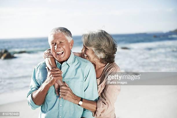 Cheerful senior couple on beach