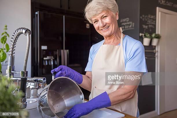 Cheerful senior housewife in the kitchen. Debica, Poland