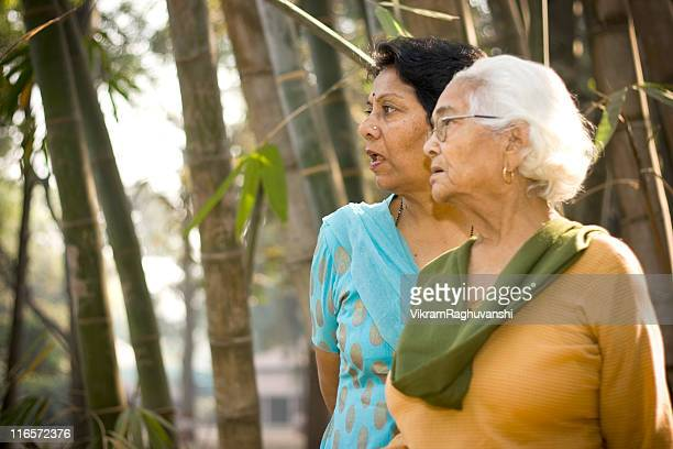 Cheerful senior Indian Asian Mother and Daughter outdoor portrait