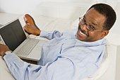 Cheerful Senior Man Using Laptop