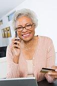 Cheerful Senior Woman Using Laptop, Holding Credit Card