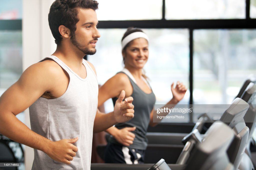 Cheerful smiling and beautiful people running at the fitness club. : Stock Photo