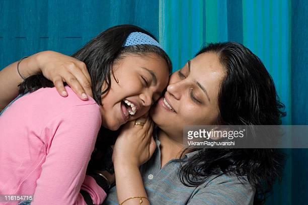 Cheerful Smiling Loving Indian Mother Daughter Hug Embracing Horizontal