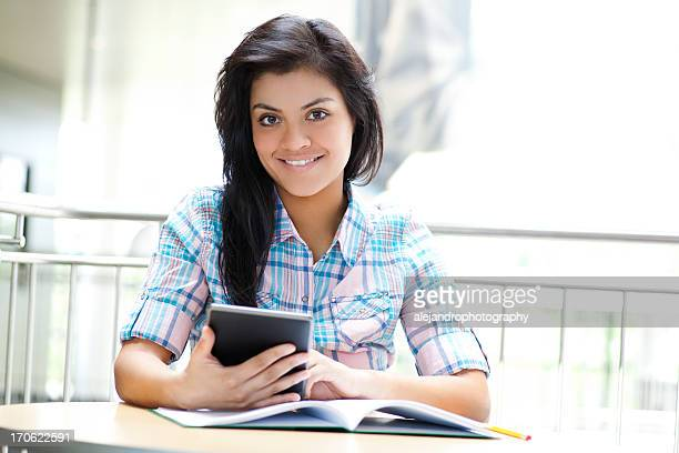 Cheerful student using a digital tablet