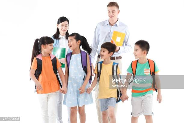 Cheerful students and teachers