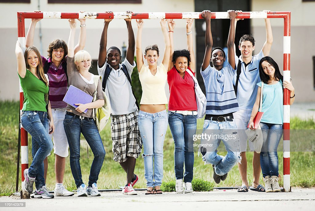 Cheerful teenage friends standing at the playground. : Stock Photo