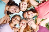 Close-up of cheerful teenage girls