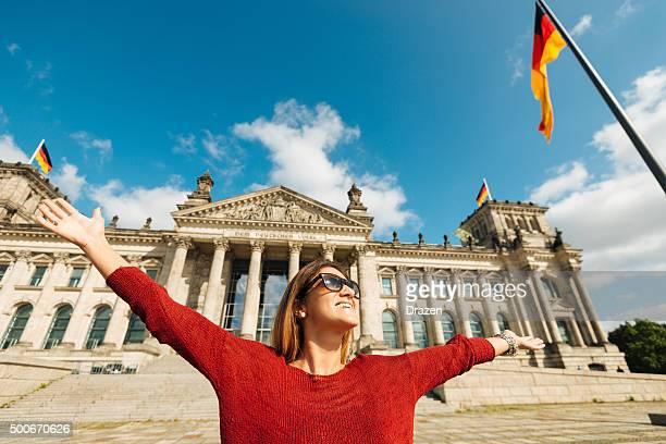 Cheerful woman feels happiness near Bundestag in Berlin, Germany