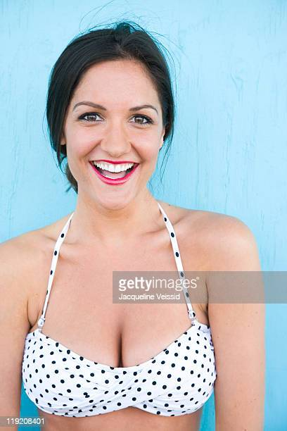 Cheerful woman in polka dot bikini smiling