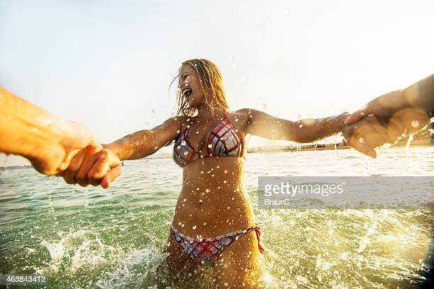Cheerful woman in the sea.