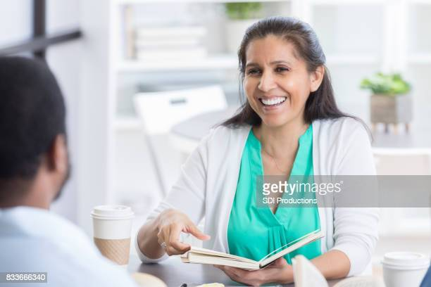 Cheerful woman leads office discussion