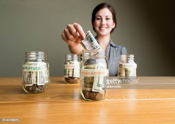 Cheerful woman saving money