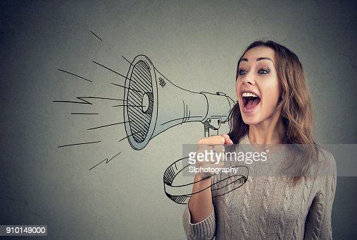 Cheerful woman sharing with news using loudspeaker : Stock Photo