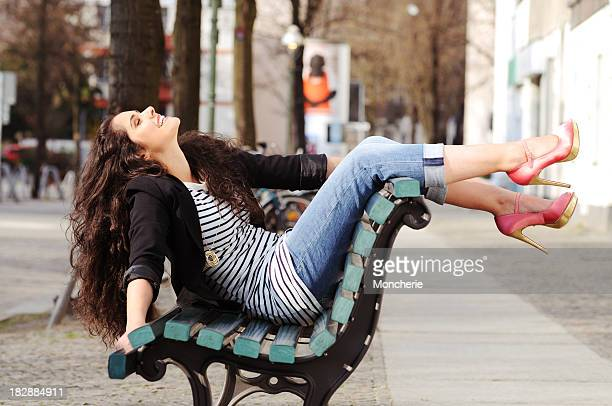 Cheerful woman sitting on a bench