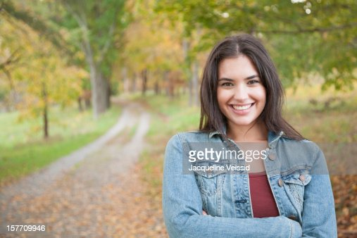 Cheerful woman standing on path in nature stock photo for Cheerful nature